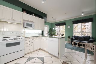 "Photo 9: 212 3098 GUILDFORD Way in Coquitlam: North Coquitlam Condo for sale in ""MARLBOROUGH HOUSE"" : MLS®# R2225808"