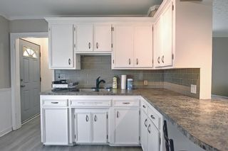 Photo 11: 420 Thornhill Place NW in Calgary: Thorncliffe Detached for sale : MLS®# A1146639