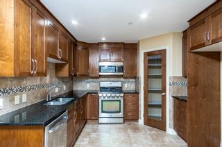 Photo 9: 2 Mackenzie Way: Carstairs Detached for sale : MLS®# A1132226