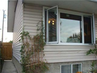 Photo 3: 707 58 Street SE in Calgary: Penbrooke Residential Detached Single Family for sale : MLS®# C3631943