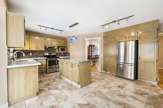 Photo 17: 312 Hawkstone Close NW in Calgary: Hawkwood Detached for sale : MLS®# A1084235