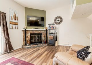 Photo 4: 19 Coachway Green SW in Calgary: Coach Hill Row/Townhouse for sale : MLS®# A1144999