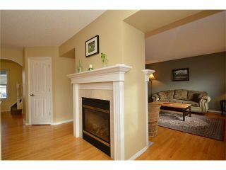 Photo 12: 120 SUNTERRA Heights: Cochrane House for sale : MLS®# C4103132