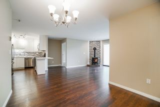 """Photo 11: 102 5379 205 Street in Langley: Langley City Condo for sale in """"Heritage Manor"""" : MLS®# R2447555"""