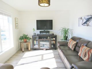 Photo 4: 1558 McAlpine Street: Carstairs Semi Detached for sale : MLS®# A1081216