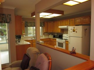 """Photo 3: 210 2451 GLADWIN Road in Abbotsford: Abbotsford West Condo for sale in """"Centennial Court"""" : MLS®# R2145469"""