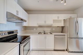 """Photo 2: 302 15272 20 Avenue in Surrey: King George Corridor Condo for sale in """"WINDSOR COURT"""" (South Surrey White Rock)  : MLS®# R2602233"""