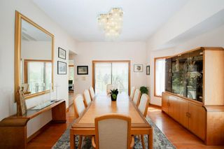 Photo 6: 27 Strathlorne Bay SW in Calgary: Strathcona Park Detached for sale : MLS®# A1120430