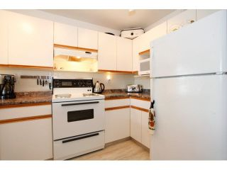 "Photo 9: 311 5955 177B Street in Surrey: Cloverdale BC Condo for sale in ""WINDSOR PLACE"" (Cloverdale)  : MLS®# F1433073"