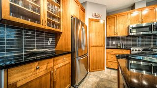 Photo 19: 38 Somme Boulevard SW in Calgary: Garrison Woods Row/Townhouse for sale : MLS®# A1112371