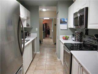 Photo 6: 104 16137 83RD Avenue in Surrey: Fleetwood Tynehead Condo for sale : MLS®# F1418870