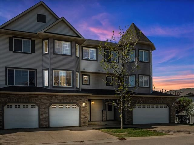 Executive townhouse in Wood Buffalo with attached garage.