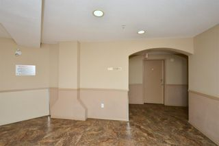 Photo 4: 1304 60 Panatella Street NW in Calgary: Panorama Hills Apartment for sale : MLS®# A1131653