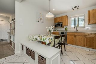 """Photo 6: 309 2733 ATLIN Place in Coquitlam: Coquitlam East Condo for sale in """"Atlin Court"""" : MLS®# R2355096"""