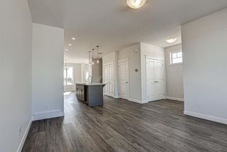 Photo 5: 136 Creekside Drive SW in Calgary: C-168 Semi Detached for sale : MLS®# A1108851