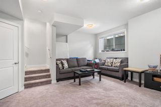 Photo 23: 1404 Jumping Pound Common: Cochrane Row/Townhouse for sale : MLS®# A1146897