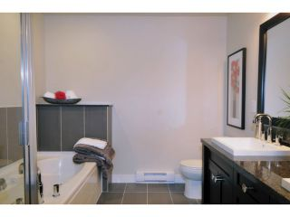 """Photo 14: 124 1480 SOUTHVIEW Street in Coquitlam: Burke Mountain Townhouse for sale in """"CEDAR CREEK"""" : MLS®# V1031667"""
