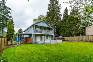 Photo 1: 9049 148 Street in Surrey: Bear Creek Green Timbers House for sale : MLS®# R2616008