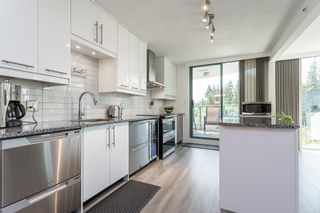 """Photo 11: 404 32330 SOUTH FRASER Way in Abbotsford: Central Abbotsford Condo for sale in """"Town Centre Tower"""" : MLS®# R2605342"""