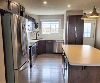 Photo 10: 1404 Clover Link: Carstairs Row/Townhouse for sale : MLS®# A1073804