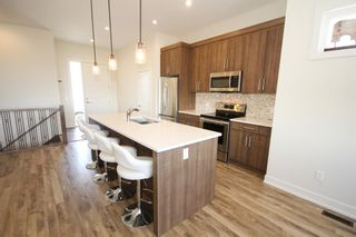 Photo 10: 646 Country Meadows Close: Turner Valley Detached for sale : MLS®# A1102004
