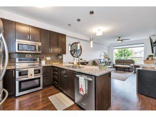 "Photo 2: 201 6480 194 Street in Surrey: Clayton Condo for sale in ""Waterstone - Esplande"" (Cloverdale)  : MLS®# R2509715"