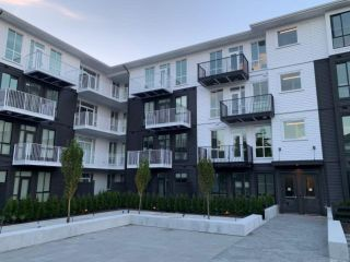 """Photo 2: 205 10168 149TH Street in Surrey: Guildford Condo for sale in """"Guildhouse II"""" (North Surrey)  : MLS®# R2398083"""