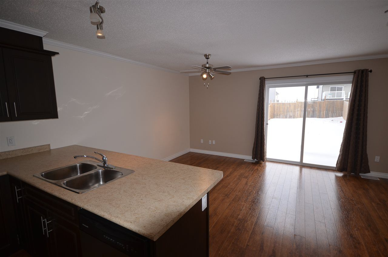 Photo 3: Photos: 11407 89A Street in Fort St. John: Fort St. John - City NE 1/2 Duplex for sale (Fort St. John (Zone 60))  : MLS®# R2143713