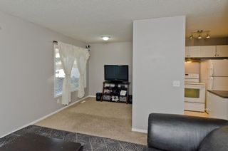 Photo 17: 163 Stonemere Place: Chestermere Row/Townhouse for sale : MLS®# A1040749