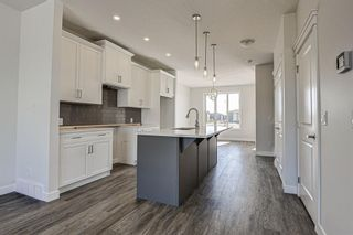 Photo 8: 136 Creekside Drive SW in Calgary: C-168 Semi Detached for sale : MLS®# A1108851