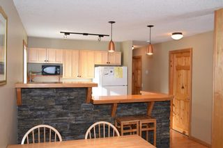 Photo 2: 101 1206 Bow Valley Trail: Canmore Row/Townhouse for sale : MLS®# C4290346