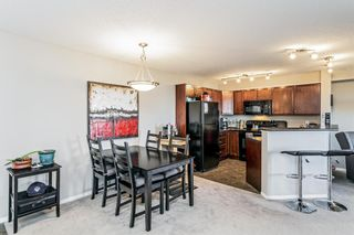 Photo 5: 2411 8 BRIDLECREST Drive SW in Calgary: Bridlewood Apartment for sale : MLS®# A1053319
