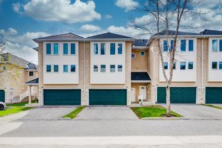 Photo 2: 91 Candle Terrace SW in Calgary: Canyon Meadows Row/Townhouse for sale : MLS®# A1107122