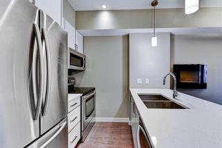 Photo 5: 211 28 Auburn Bay Link SE in Calgary: Auburn Bay Apartment for sale : MLS®# A1076356