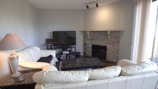 Photo 5: 1 10 POINT Drive NW in Calgary: Point McKay Row/Townhouse for sale : MLS®# A1089848