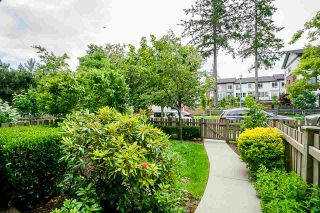 """Photo 2: 8 2738 158 Street in Surrey: Grandview Surrey Townhouse for sale in """"CATHEDRAL GROVE"""" (South Surrey White Rock)  : MLS®# R2463712"""