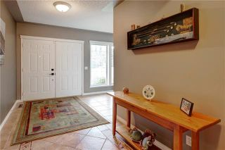 Photo 3: 5 PROMINENCE Path SW in Calgary: Patterson Semi Detached for sale : MLS®# A1061630