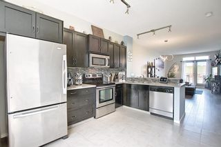 Photo 5: 2304 125 Panatella Way NW in Calgary: Panorama Hills Row/Townhouse for sale : MLS®# A1121817