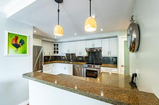 """Photo 4: 704 1450 PENNYFARTHING Drive in Vancouver: False Creek Condo for sale in """"HARBOUR COVE"""" (Vancouver West)  : MLS®# R2594220"""