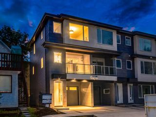 Main Photo: 413 7 Street NW in Calgary: Sunnyside Row/Townhouse for sale : MLS®# A1033699