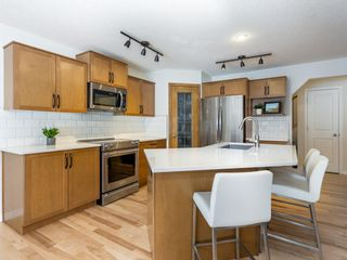Photo 7: 45 Tuscany Valley Hill NW in Calgary: Tuscany Detached for sale : MLS®# A1077042