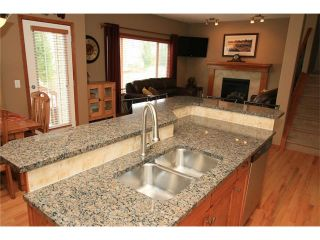 Photo 10: 18 WEST POINTE Manor: Cochrane House for sale : MLS®# C4072318