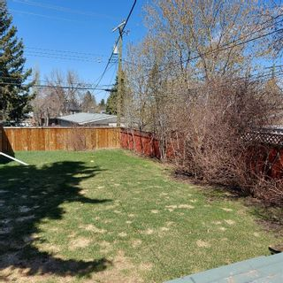 Photo 5: 208 25 Avenue NW in Calgary: Tuxedo Park Detached for sale : MLS®# A1109100