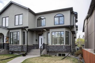 Main Photo: 711 50 Avenue SW in Calgary: Windsor Park Semi Detached for sale : MLS®# A1110569
