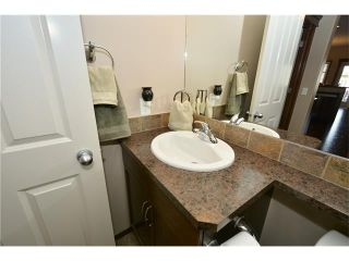 Photo 16: 14 WEST POINTE Manor: Cochrane House for sale : MLS®# C4108329