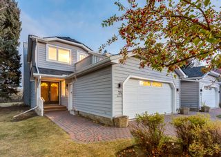 Main Photo: 24 WOOD Crescent SW in Calgary: Woodlands Row/Townhouse for sale : MLS®# A1154480