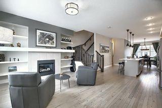 Photo 3: 374 Quarry Park Boulevard SE in Calgary: Douglasdale/Glen Row/Townhouse for sale : MLS®# A1063797