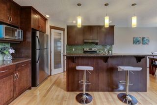 Photo 6: 122 Panatella Way NW in Calgary: Panorama Hills Detached for sale : MLS®# A1147408