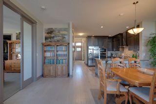 Photo 19: 40 Cougar Ridge Landing SW in Calgary: Cougar Ridge Row/Townhouse for sale : MLS®# A1148928