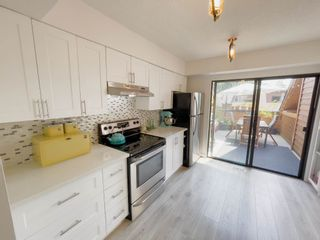 """Photo 9: 405 CARDIFF Way in Port Moody: College Park PM Townhouse for sale in """"EASTHILL"""" : MLS®# R2598640"""